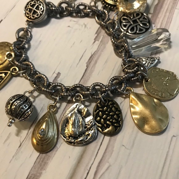 Gold and silver tone charm bracelet